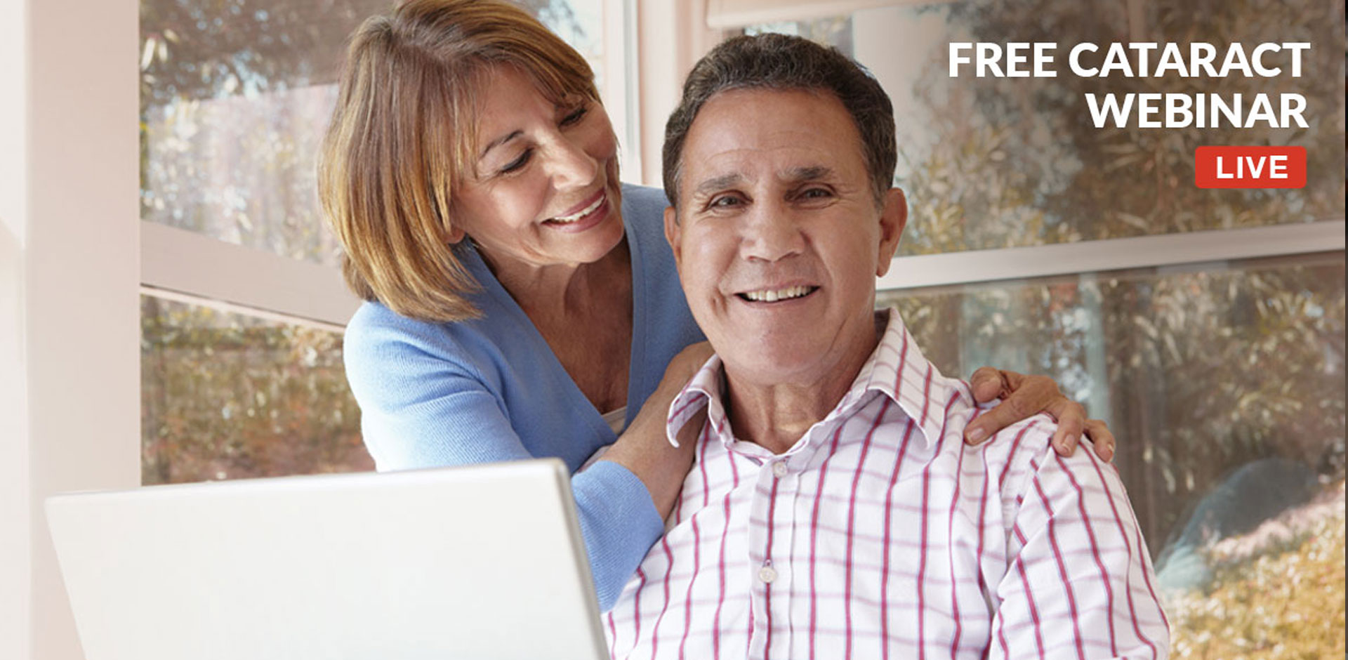 Middle Aged couple Watching The Free Laser Cataract Webinar