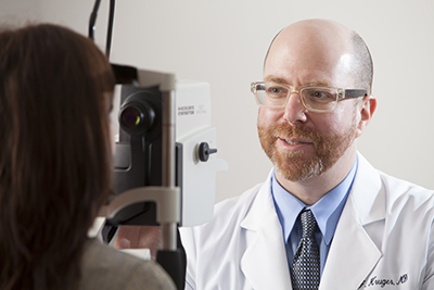Eye Doctor Diagnosing Cataracts