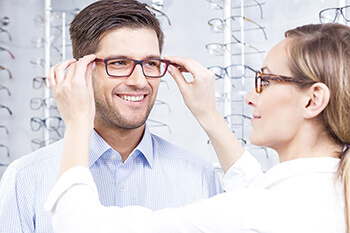 Man being fitted with eyeglasses