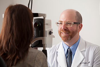 Eye Doctor examining a patient's Retina