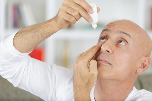 Man treating his dry eye