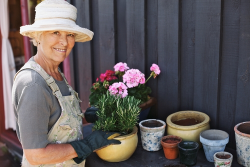 Older woman with cataracts working with plants