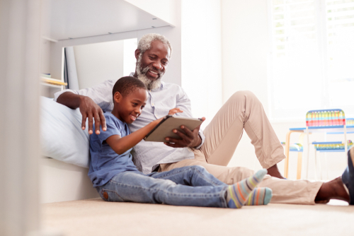 grandfather and grandson using ipad